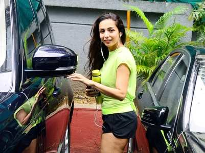 Malaika adds a pop of neon to her gym look