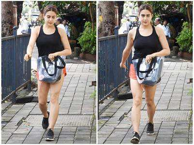 Photos: Sara awkwardly covers her shorts