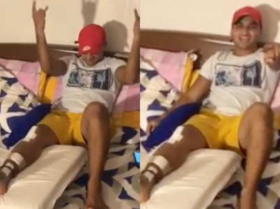 Faisal dances on his bed with an injured leg
