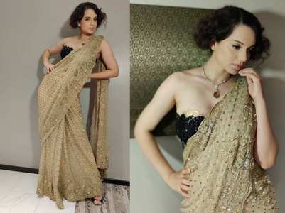 Kangana sizzles in a saree at an award night!