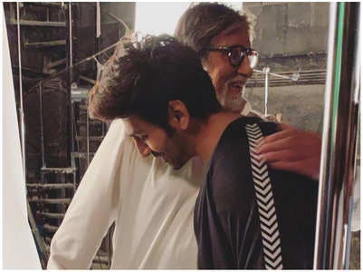 Big B-Kartik Aaryan share a hug on the sets