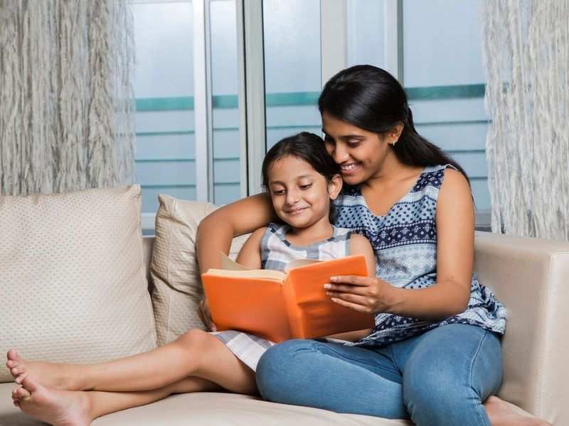 Reading to children from real books is better than reading from tablets - Times of India