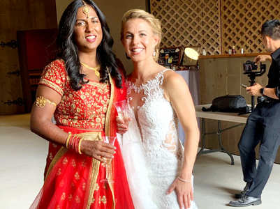 This Indo-American lesbian couple donned a red lehenga and white gown for their grand wedding