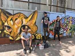 This graffiti artist is on a mission to beautify 100 walls in the city