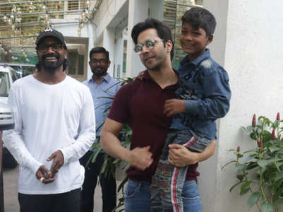 Varun Dhawan poses with a little fan