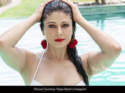 Pooja Batra flaunts herself in a white bikini