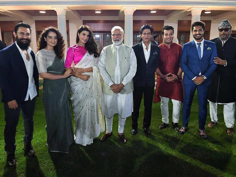 PM Narendra Modi with Bollywood actors in New Delhi on Saturday. (ANI photo)