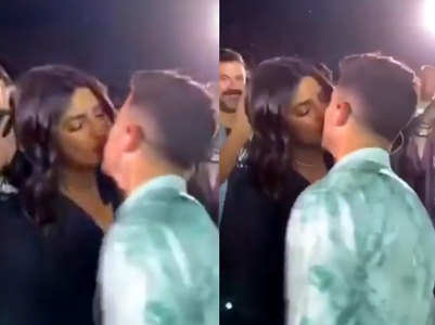 Watch: PC steals a kiss from Nick at a concert
