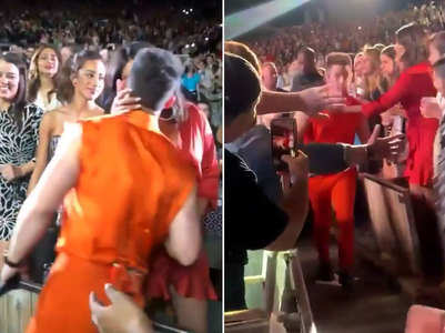 Watch:Nick kisses PC at the concert