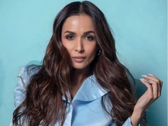 Malaika Arora adds a stylish twist to formals and we're loving it!