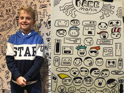 Restaurant hires a 9-year-old child to doodle on their walls!