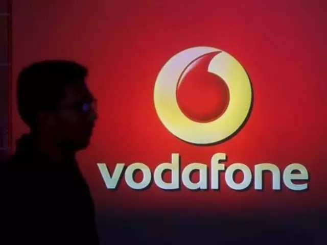 Vodafone threatens to quit India over high taxes