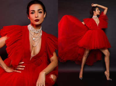 Malaika Arora SHOCKS and STUNS in red hot dress with naked heels