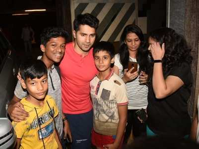 Varun poses for pics with his fans outside gym