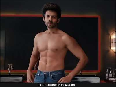 Kartik slammed for showing fake abs in an ad