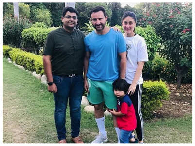 Taimur looks cute as he clings onto Saif