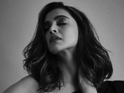 Deepika Padukone flaunts her new hairdo in a sexy black gown