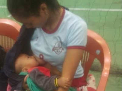 Mizoram volleyball player stops to feed her baby between the game