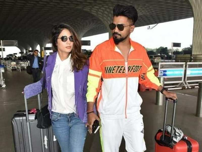 Hina Khan and Rocky Jaiswal leave for holidays; make a stylish statement at the airport