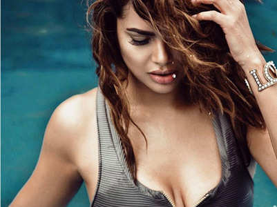 Esha sets temperatures soaring in a monokini