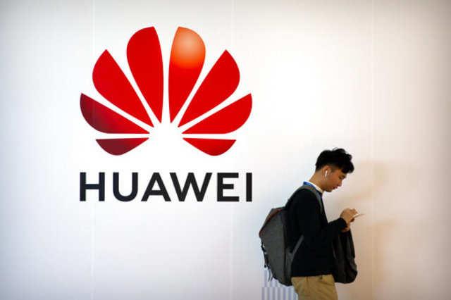 Merkel seeks to delay German Huawei position until after March EU summit: Sources