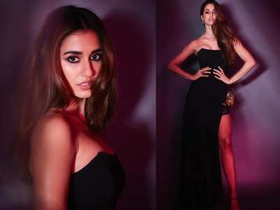 Disha stuns in a black thigh-slit ensemble
