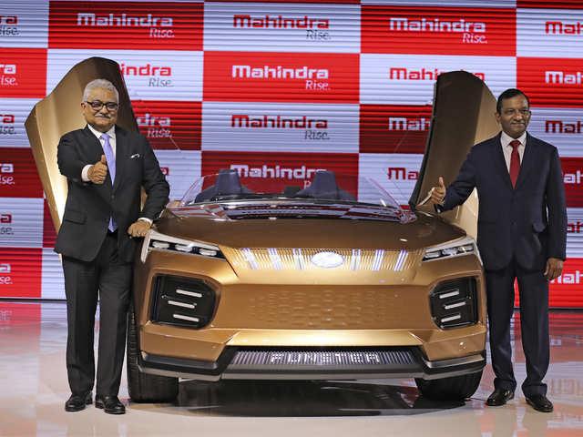 Pawan Kumar Goenka and Rajan Wadhera pose at the launch of Mahindra Funster Electric concept at the Auto Expo in Greater Noida.