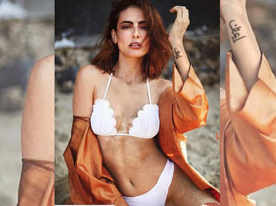 Mandana poses in a sizzling white bikini