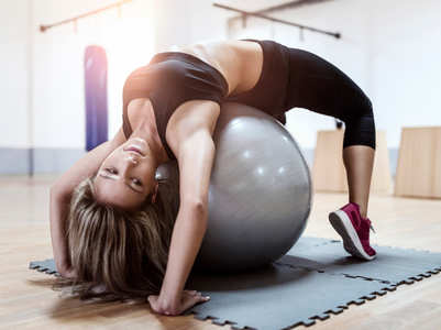 4 moves to perform with an exercise ball to get rid of nasty back pain