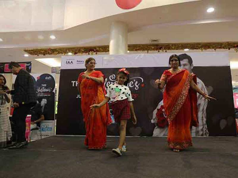Grandparents walk the ramp with their grandchildren at the V-Day celebrations at the mall
