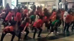 Kids dance for road safety along with volunteers