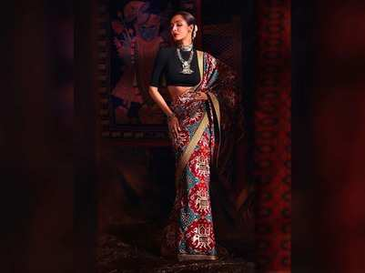 Malaika looks stunning a saree & a crop top