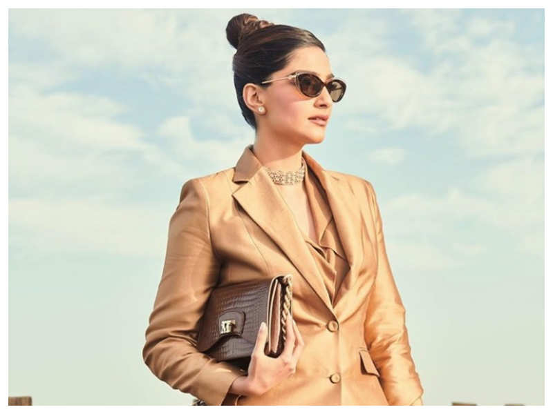 Photos: Sonam Kapoor Ahuja gives out major boss lady vibes in her gold pantsuit