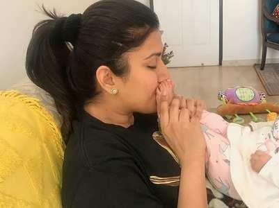 Karan Patel's wife kisses her baby girl's feet