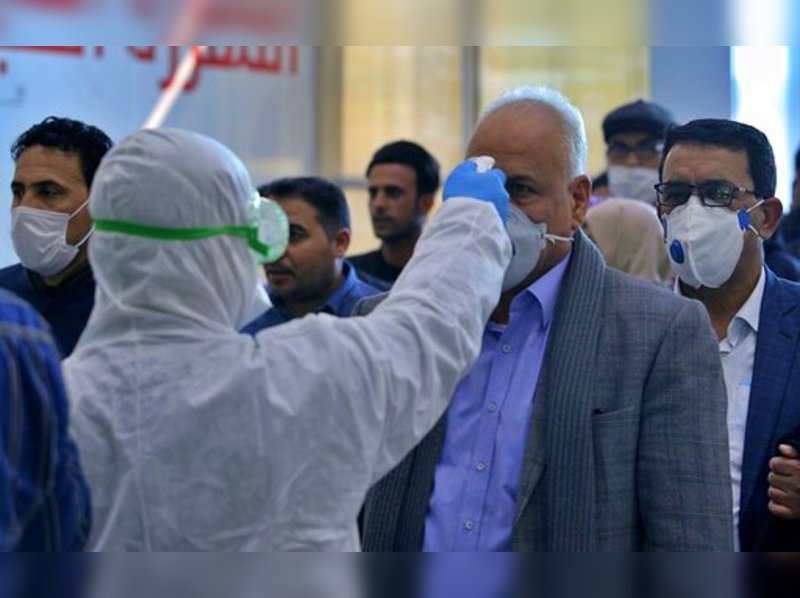 Medical staff checking passengers arriving from Iran in the airport in Najaf, Iraq, Friday, Feb. 21, 2020. Iraqi authorities are taking precautions at Najaf and other Iraqi airports, as well as at the border gates with Iran, after the discovery of the new virus that emerged in China in Iran.Photo/Anmar Khalil)