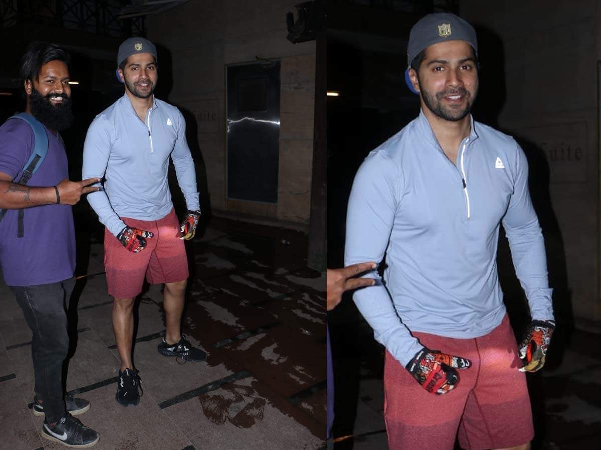 Photos Varun Dhawan is all smiles as he gets snapped outside his ...