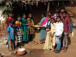 Students feed the hungry on Holi