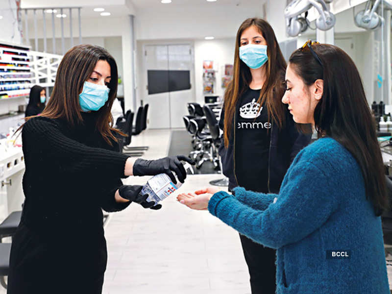 Salons are ensuring complete hygiene with masks and sanitisers, while not allowing sick customers to enter