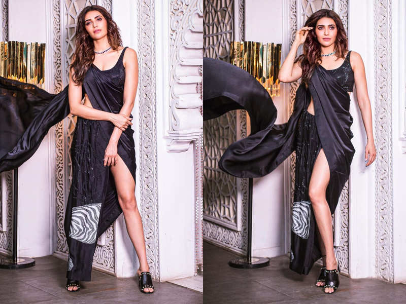 Karishma Tanna's thigh-high slit black sari is the sexiest take on the classic drape