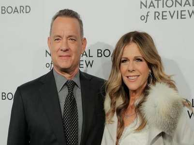 Tom Hanks & wife return to Los Angeles