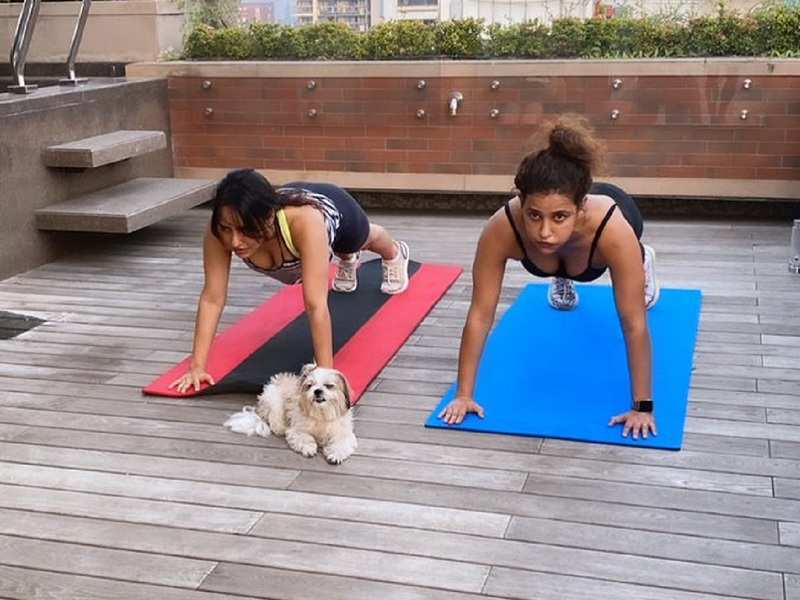 Neha Sharma and Aisha Sharma workout with their furry friend and it is just too cute to be missed