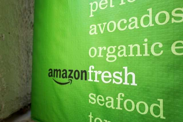 Amazon entices warehouse employees to grocery unit with higher pay