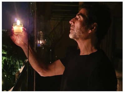 Akshay Kumar lights a candle in his balcony
