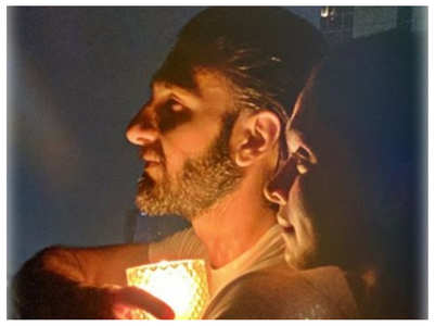 Ranveer Singh lights a candle with Deepika