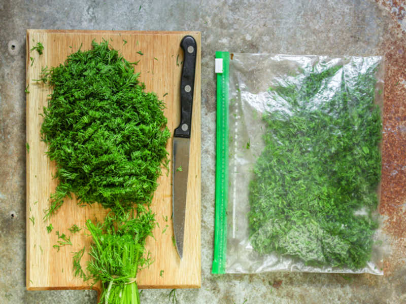 Cut herb ends and place the herbs in a resealable bag in the fridge