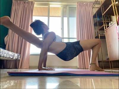 Esha aces an advanced yoga pose in THIS pic