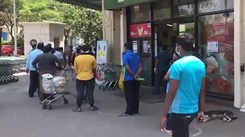Watch Mumbaikars maintain social distancing while standing in queues to buy essentials