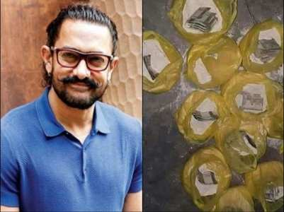 Did Aamir distribute money in flour packets?