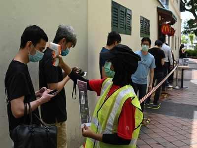 Singapore announces new virus death, 486 new cases