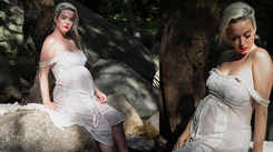 Pregnant Katy Perry channels the goddess in her as she shows off her baby bump in off-white lacy dress